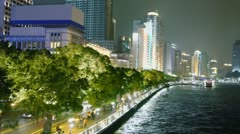 People walk by quay with traffic near Pearl river and cityscape Stock Footage