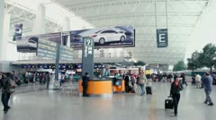 Many passengers walk in huge hall of airport, panoramic motion Stock Footage