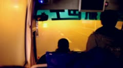 Silhouette of driver and passenger rides in bus by motorway Stock Footage