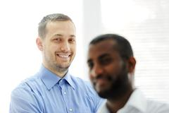 african american and caucasian business man together - stock photo