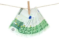 Laundering Money Isolated on a White Background Stock Photos