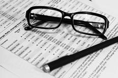 Glasses, financial documents and  pencil Stock Photos
