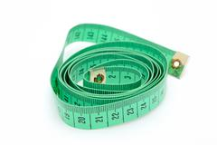 detail image of twisted green inch tape. - stock photo