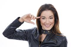 girl keep finger near head - stock photo
