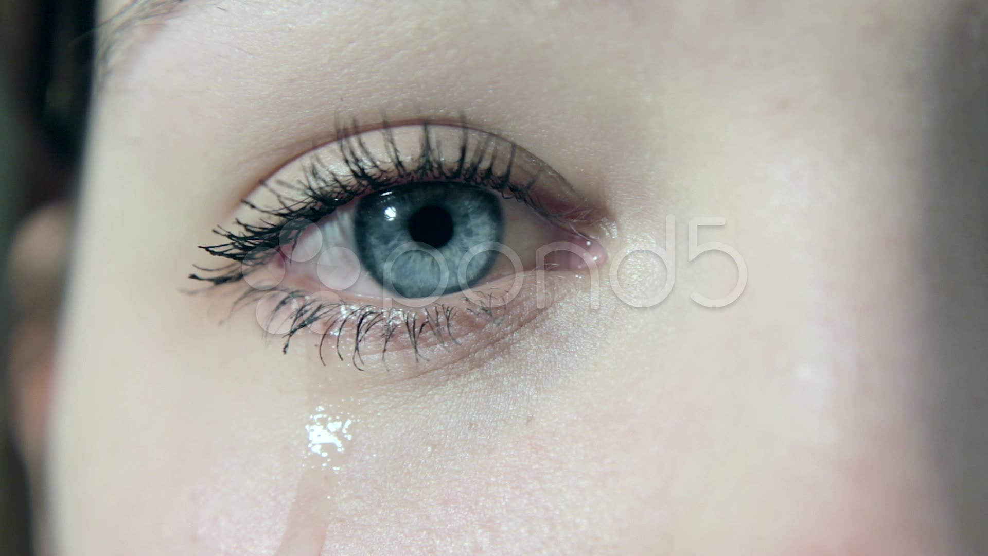 Crying girl with tears in her beautiful eyes in 1080p ...