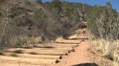 130205 woman running up manitou incline Stock Footage