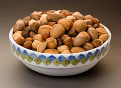 mixed nuts bowl isolated - stock photo