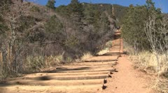130205e woman running up the manitou incline to the right Stock Footage