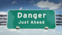Danger ahead highway roadsign - stock footage