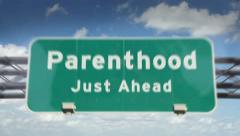 Parenthood ahead highway roadsign Stock Footage