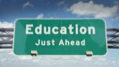 Education ahead highway roadsign - stock footage