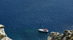 Small yacht anchored off the Santorini coast. Stock Footage