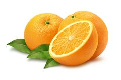 oranges & leaves isolated with a clipping path - stock photo