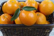 Basket of fresh oranges Stock Photos