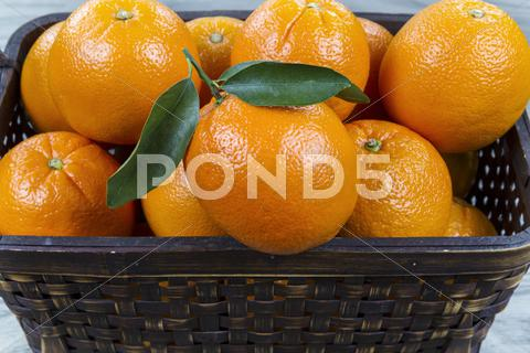 Stock photo of basket of fresh oranges