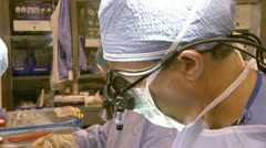 Doctor Extreme Close-Up While Performing Surgery Stock Footage