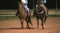 Handlers Riding Horses on Track After Race Stock Footage