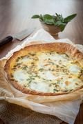 quiche with ham and sage - stock photo