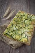 sliced pizza with zucchini - stock photo