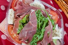 italian salad with ham - stock photo