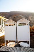 Beach cabins, perissa, santorini, greece Stock Photos