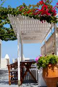 Terrace setting in thira, santorini Stock Photos