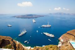 cruise ships in santorini, greece - stock photo