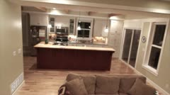 a living room and a kitchen in a country house jib shot - stock footage