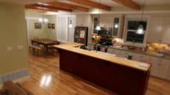 A kitchen and dining room in a country house jib shot Stock Footage