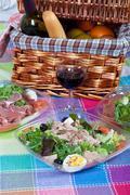 pic-nic basket and salads - stock photo