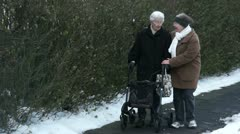 Assisted walking with senior lady - stock footage