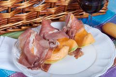 cantaloupe melon with italian ham - stock photo