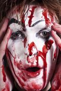 Stock Photo of mime with stained blood feca