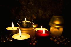 Group of candles against a dark background Stock Photos