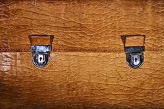 lock of an old beige leather portfolio - stock photo