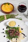 Stock Photo of beef on arugula salad and parmesan