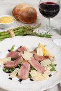 Beef on arugula salad and parmesan Stock Photos