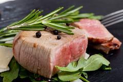 beef on arugula salad and parmesan - stock photo