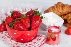 strawberries and croissant - stock photo