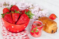 Strawberries and croissant Stock Photos