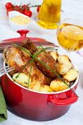 Chicken and potatoes Stock Photos