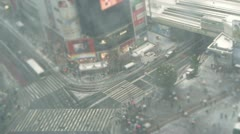 TOKYO - TILT - Train and Traffic at Snow Shibuya Crossing Stock Footage