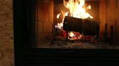 A jib shot of a roaring fireplace and mantel Stock Footage