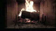 A jib shot of roaring fireplace and mantel Stock Footage