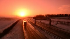 Traffic on A1/M motorway at sunrise in winter snow, united kingdom Stock Footage