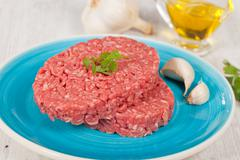 raw hamburger - stock photo