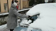 Removing ice from the car windshield,. - stock footage