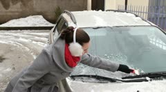 Removing ice from the car windshield. Stock Footage