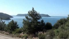 Road pine and islands zoom out tilt Stock Footage