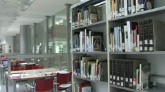 Slow walk in a library - stock footage
